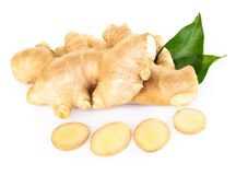 Fresh ginger root with sliced islolated on white background for herb and medical product concept. Fresh ginger root with sliced islolated on white background for stock photo