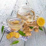 Fresh ginger root with tea. Royalty Free Stock Photo