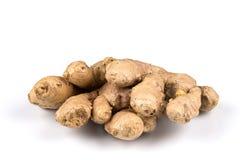 Fresh ginger on white background. Fresh organic ginger on a white background Royalty Free Stock Photos