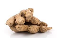Fresh ginger on white background. Fresh organic ginger on a white background Royalty Free Stock Images