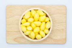 Fresh Ginkgo nut in wooden bowl top view Royalty Free Stock Photos