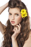 Fresh girl with yellow flower in hair Stock Photo