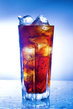 A fresh glass of cola with ice Stock Image