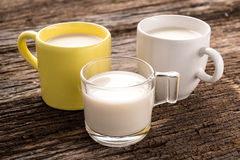 Fresh glass of milk on old wood background Royalty Free Stock Photo