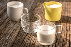 Fresh glass of milk on old wood background Royalty Free Stock Photos