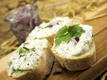 Fresh goat cheese. With herbs and onions Stock Photography