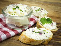 Fresh goat cheese. With herbs and onions Royalty Free Stock Image