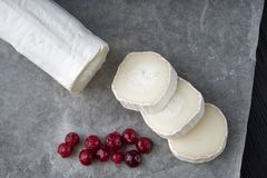 Free Fresh Goat Cheese With Red Berries Slices On Paper Royalty Free Stock Photography - 150555357
