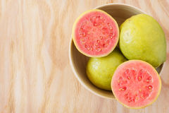 Fresh goiaba on wooden table Royalty Free Stock Photos