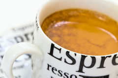 Fresh golden crema of espresso coffee. On a white background Stock Image