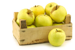 Fresh Golden Delicious apples in a wooden crate Stock Images