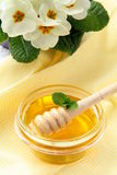 Fresh golden honey in jar with a wooden spoon Stock Images