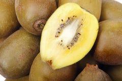 Fresh golden kiwi fruit close-up. Close-up of some golden kiwi fruits on white background Stock Photos