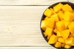 Fresh and golden mangoes. In bowl royalty free stock photo
