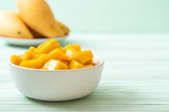 Fresh and golden mangoes. In bowl stock photos