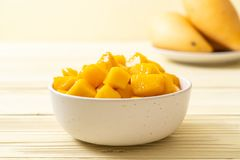 Fresh and golden mangoes. In bowl stock images
