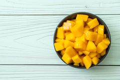 Fresh and golden mangoes. In bowl royalty free stock images