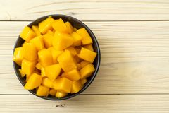 Fresh and golden mangoes. In bowl royalty free stock image