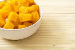 Fresh and golden mangoes. In bowl royalty free stock photos
