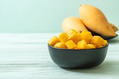 Fresh and golden mangoes. In bowl stock image
