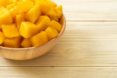 Fresh and golden mangoes. In bowl stock photo