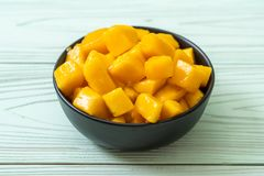 Fresh and golden mangoes. In bowl royalty free stock photography