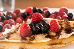 Fresh, golden pancakes with fruit and cream Royalty Free Stock Image