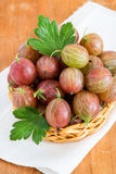 Fresh gooseberries in basket over light background Stock Photography