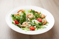 Fresh gourmet seafood salad with shrimps, greens, cherry tomatoe Stock Photos