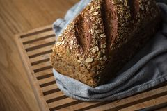 Fresh grain bread on cutting board Royalty Free Stock Photos