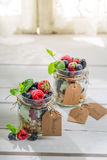 Fresh granola with fruits and yogurt. On old wooden table Royalty Free Stock Photos