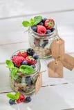 Fresh granola with yogurt and berry fruits Stock Image