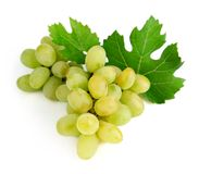 Fresh grape fruits with green leaves Stock Photo