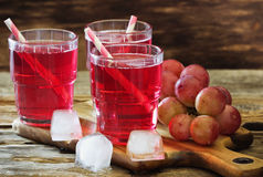 Fresh grape juice. With ice and fresh fruit. Healthy and diet food. Selective focus stock image