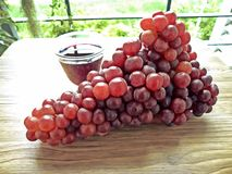 Fresh Grape juice by some Grape vines Royalty Free Stock Photos