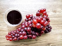 Fresh Grape juice by some Grape vines.  Stock Photography
