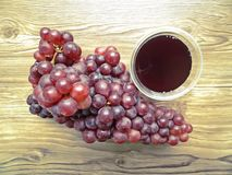 Fresh Grape juice by some Grape vines Royalty Free Stock Images