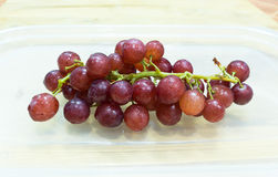 Fresh Grape. Red grapes on the lid Royalty Free Stock Photography