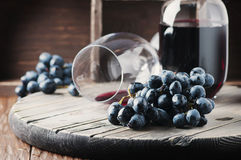 Fresh grape and red wine on the vintage table. Selective focus Stock Images