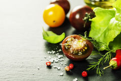 Fresh grape tomatoes with salade leaves and salt Royalty Free Stock Photo