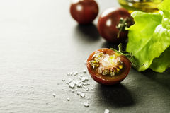 Fresh grape tomatoes with salade leaves and salt Stock Image