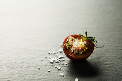 Fresh grape tomatoes with  salt Stock Photography