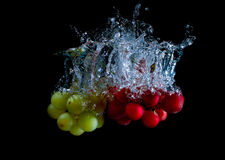 Fresh grape in water with air bubbles. Water splash royalty free stock photos