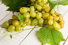 Fresh grape. On white wooden table. Selective focus stock image