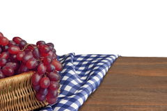 Fresh Grape In The Wicker Basket On Rustic Wood Table. Fresh Grape In The Wicker Basket On The Rustic Rough Brown Wood Table With Blue Checkered Tablecloth stock image