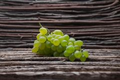 Green grape on the wood texture background Royalty Free Stock Images