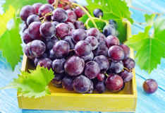 Fresh grape. In yellow box royalty free stock photos