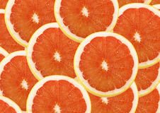 Fresh grapefruit. And slices background Stock Images