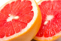 Fresh grapefruit. On white. Macro. Background Stock Images