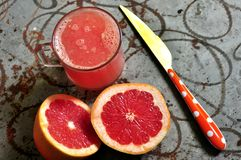 Fresh grapefruit at breakfast Stock Photography